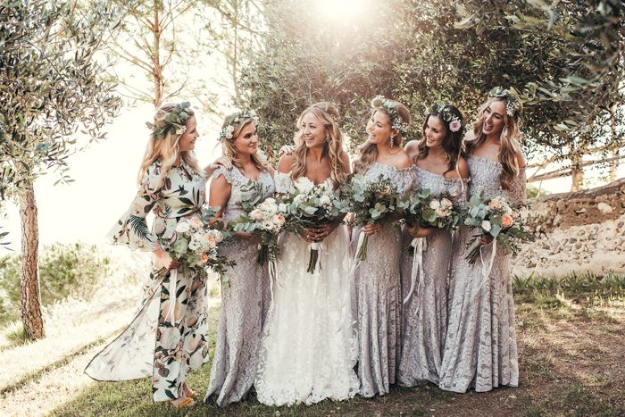 The bridesmaids were wearing lilac lace dresses by the bride's fashion brand