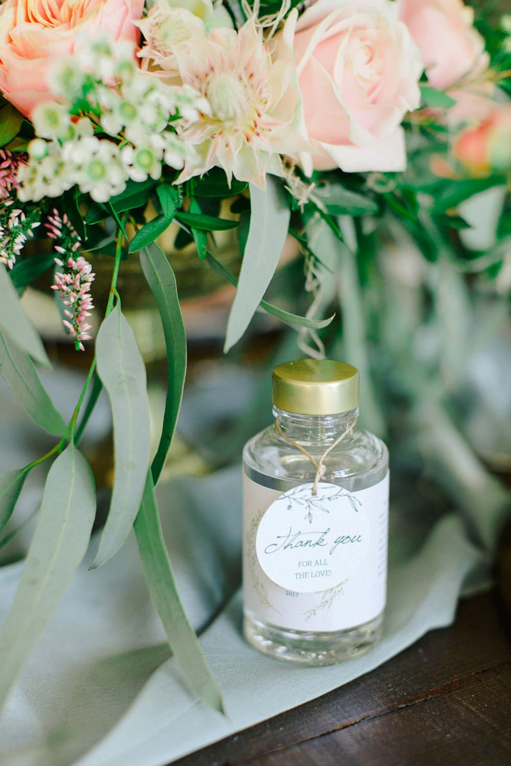 mini olive oil wedding favors with tags