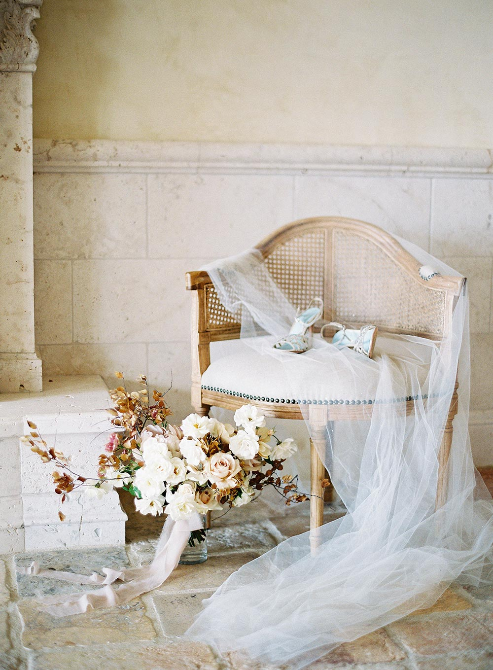 fine art boudoir styling with veil and cream bouquet