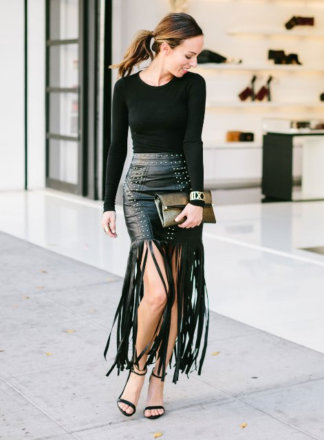 With black shirt, clutch and sandals