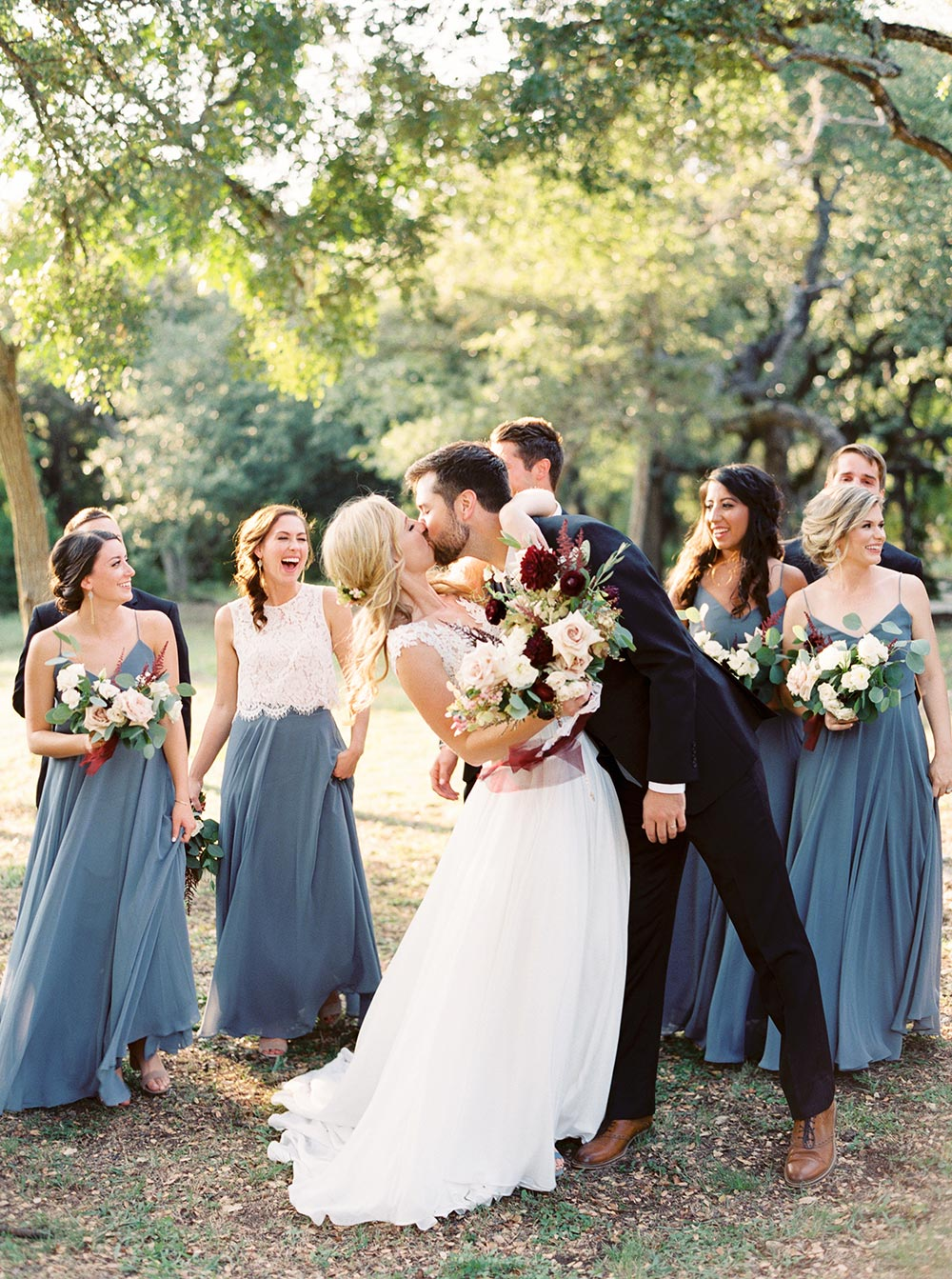 outdoor rustic chic wedding ceremony at Addison Grove bride and groom kiss