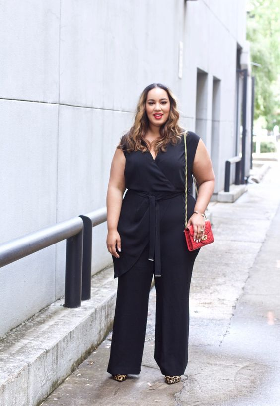 a black wrap jumpsuit with draping, leopard heels and a red bag for a chic look