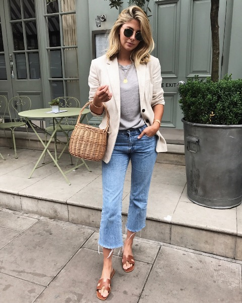With gray t-shirt, crop jeans, brown sandals and beige jacket