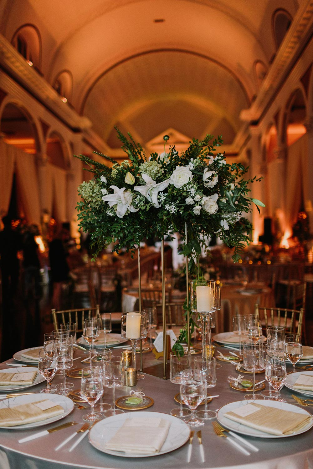 glamorous cathedral wedding reception with green and gold palette