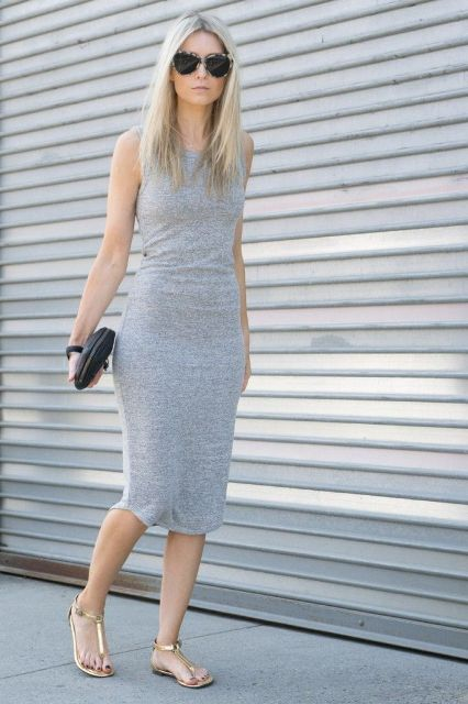 With gray midi dress and black clutch