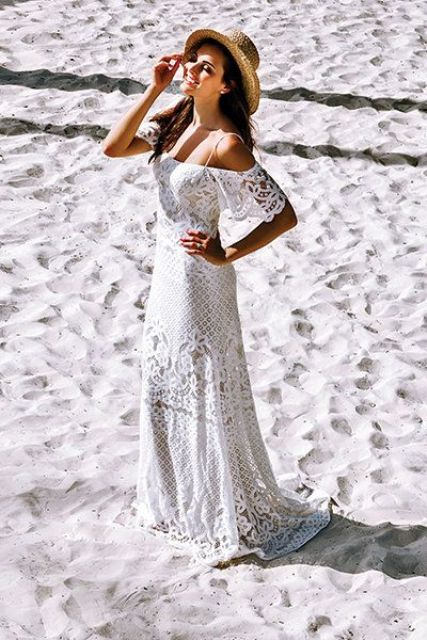 a boho lace off the shoulder sheath wedding dress with spaghetti straps for a boho beach look