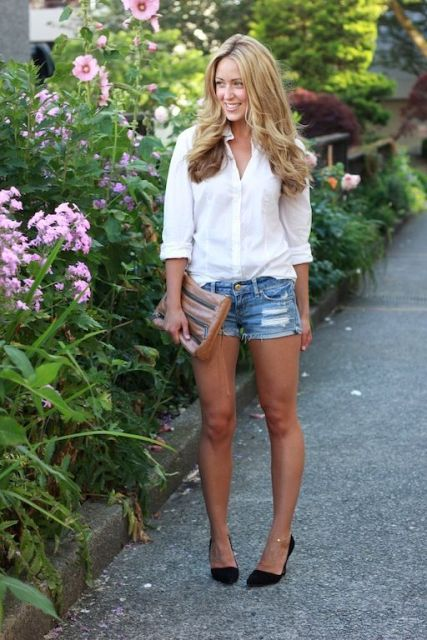 With white shirt, black pumps and clutch