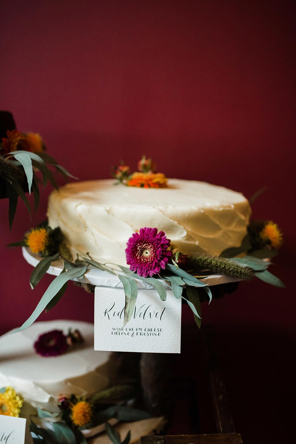 red velvet wedding cake with foraged flowers