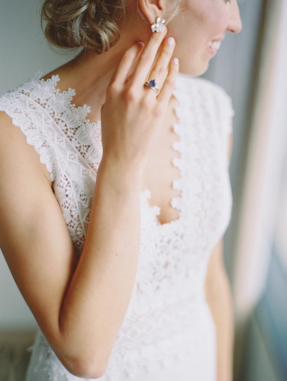 embroidered lace wedding dress with vintage blue engagement ring