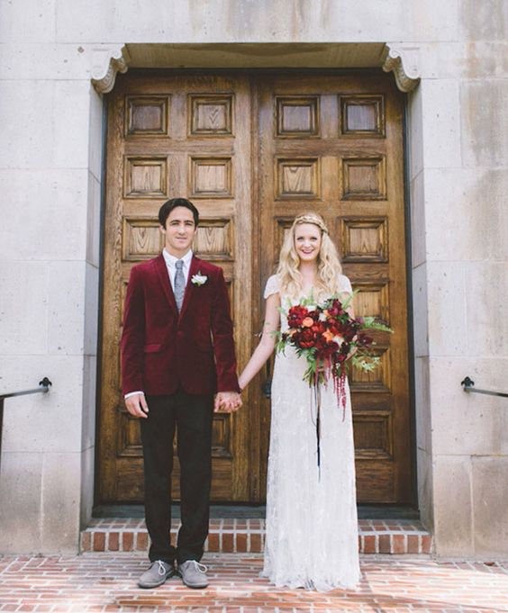 a marsala velvet jacket makes up the whole groom look adding a bold touch to the outfit