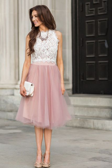 With pale pink skirt, white clutch and beige shoes