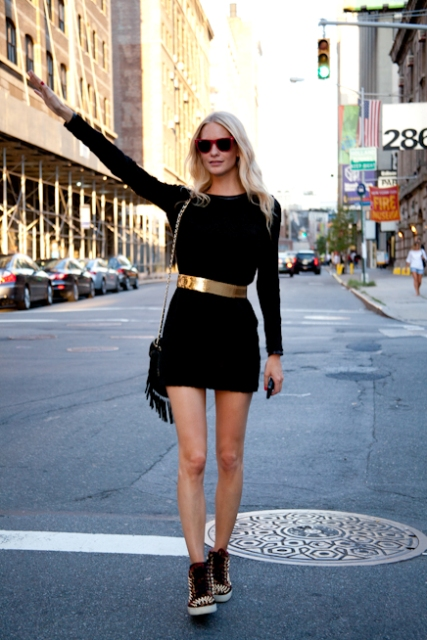 With black mini dress, fringe bag and printed sneakers