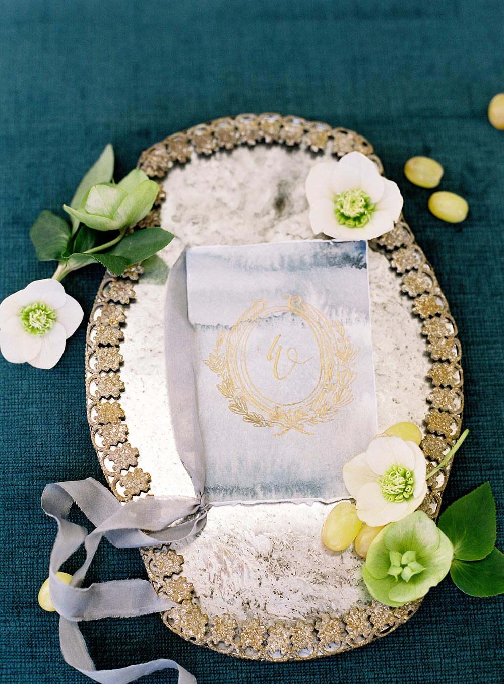 pale blue wedding programs with gold leaf crest