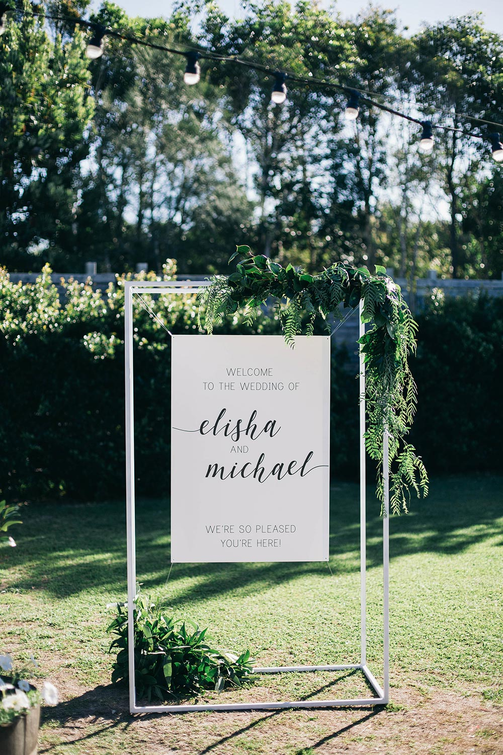 modern wedding signage with greenery