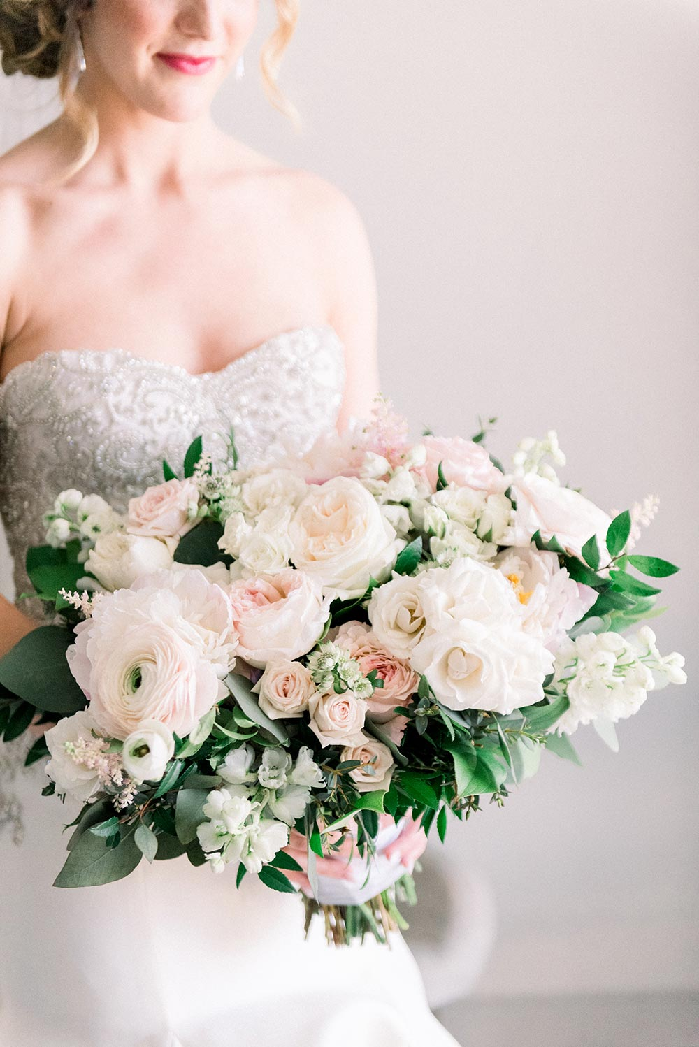 lush bridal bouquet with peonies