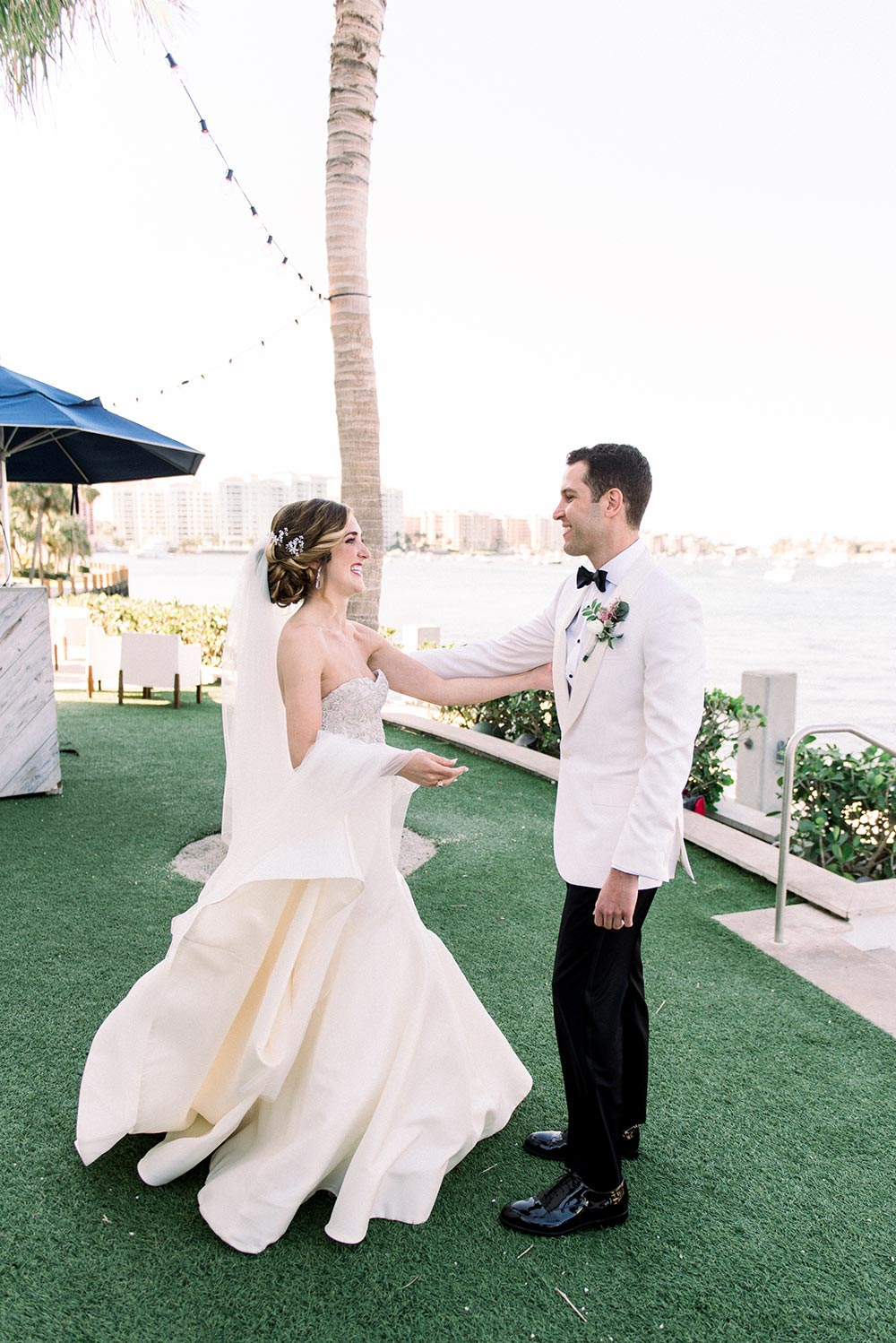 strapless embellished wedding dress and white groom tux first look