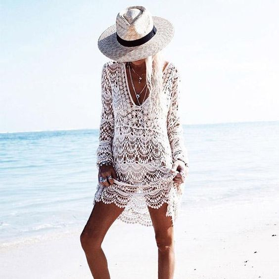 a sexy white crochet beach tunic with long sleeves for a boho girl or for honeymoon