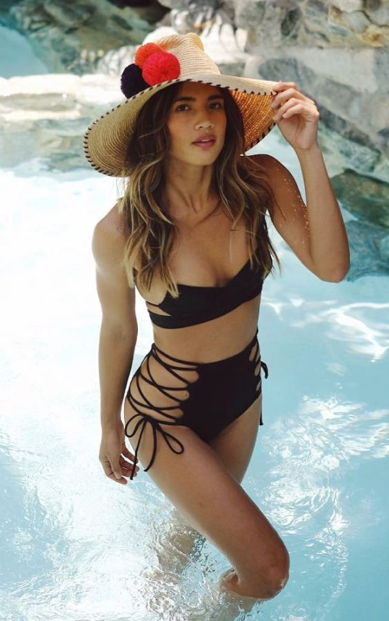 a super hot two piece swimsuit with a strapless top and a high waisted bottom with lacing up