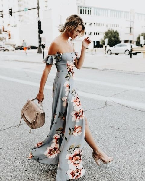 a light grey off the shoulder dress with a large floral print and a side slit