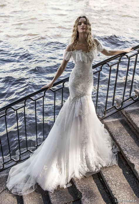 an off the shoulder sweetheart neckline mermaid wedding dress with lace, embellishments and a chapel train