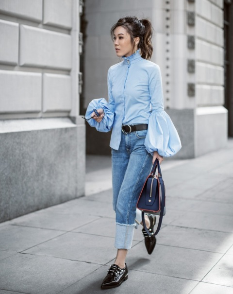 With cuffed jeans, black flat shoes, black belt and navy blue bag