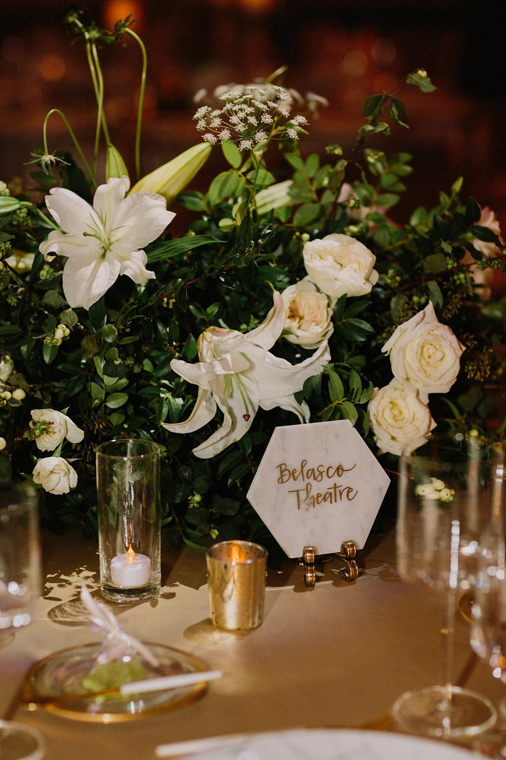 glamorous cathedral wedding reception with green and gold palette and marbled table numbers