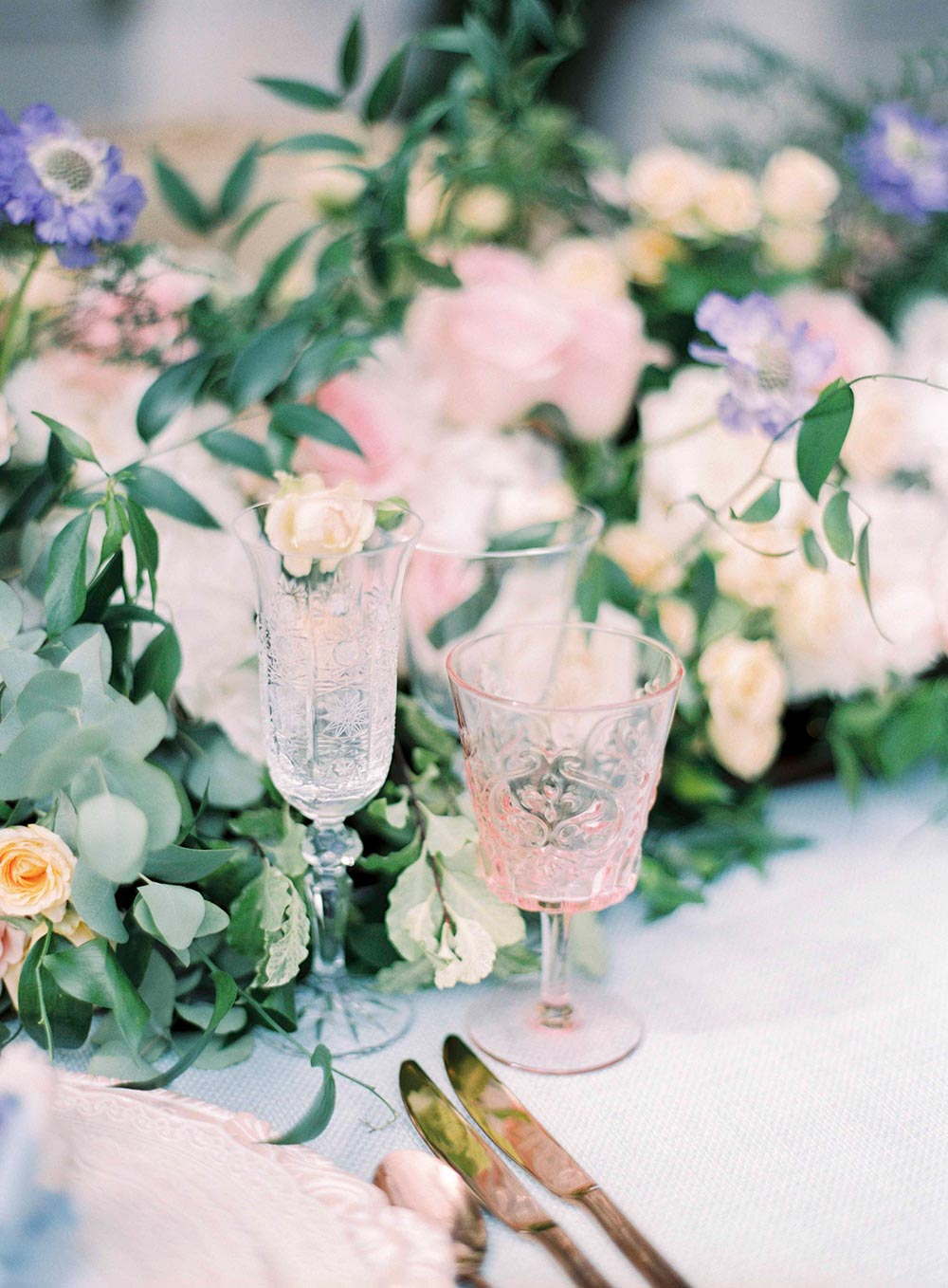 delicate wedding stemware with blush and blue hues
