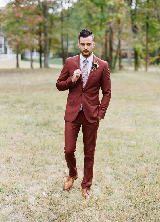 a burgundy suit, a printed pink tie, brown shoes for a non-traditional fall groom look