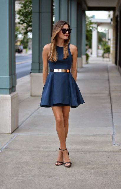 With navy blue dress and sandals