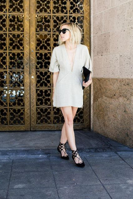 With black lace up flats and black clutch