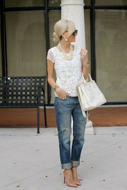 With distressed cuffed jeans, white bag and beige pumps