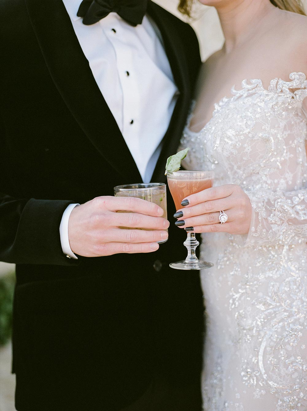 glamorous embellished long sleeve wedding dress and black velvet groom tux with wedding cocktails
