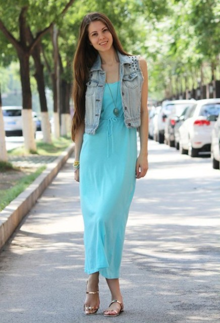 With maxi dress and denim vest