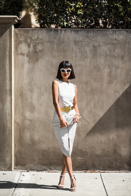 With white dress, white clutch and white sandals