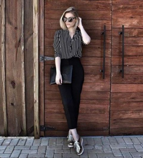 black cropped pants, a striped shirt, metallic platform shoes and a clutch