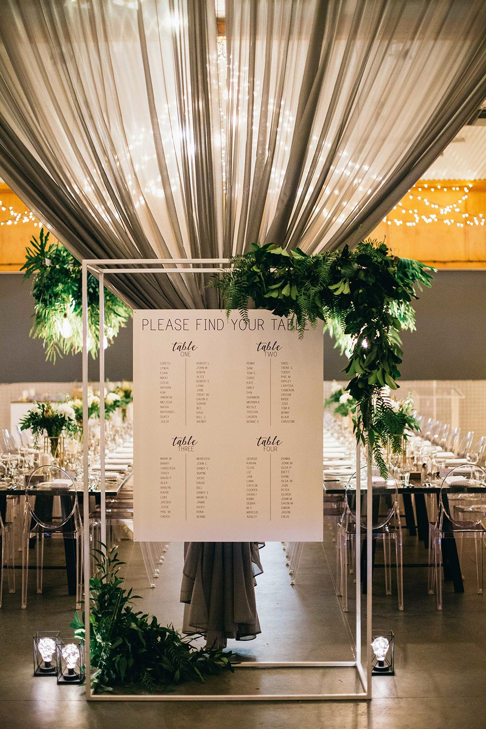 modern wedding seating chart and greenery