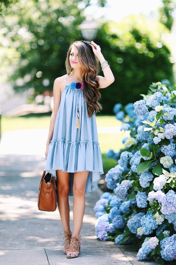 a blue mini dress with a high low skirt, pompoms is a comfy piece to wear