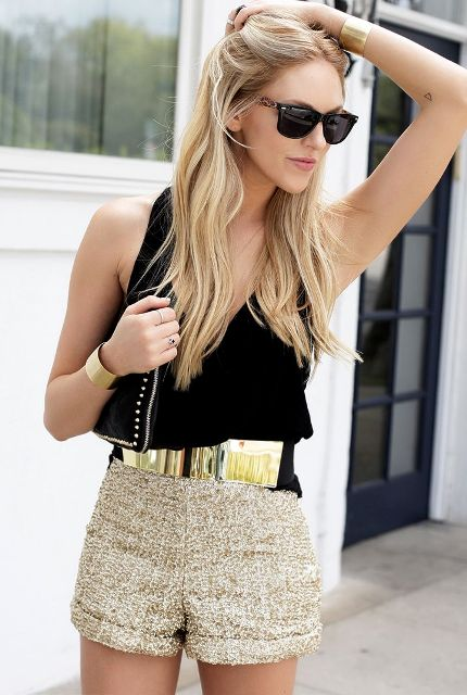 With black top, beige shorts and black bag