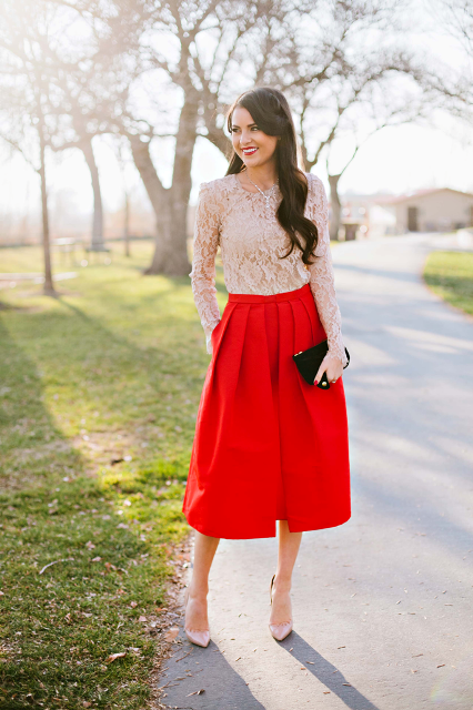 With red midi skirt, beige pumps and black clutch