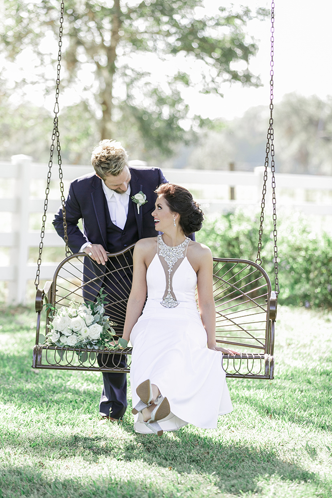 The bridal bouquet was a white and green one, I love this idea of a shot with a vintage swing