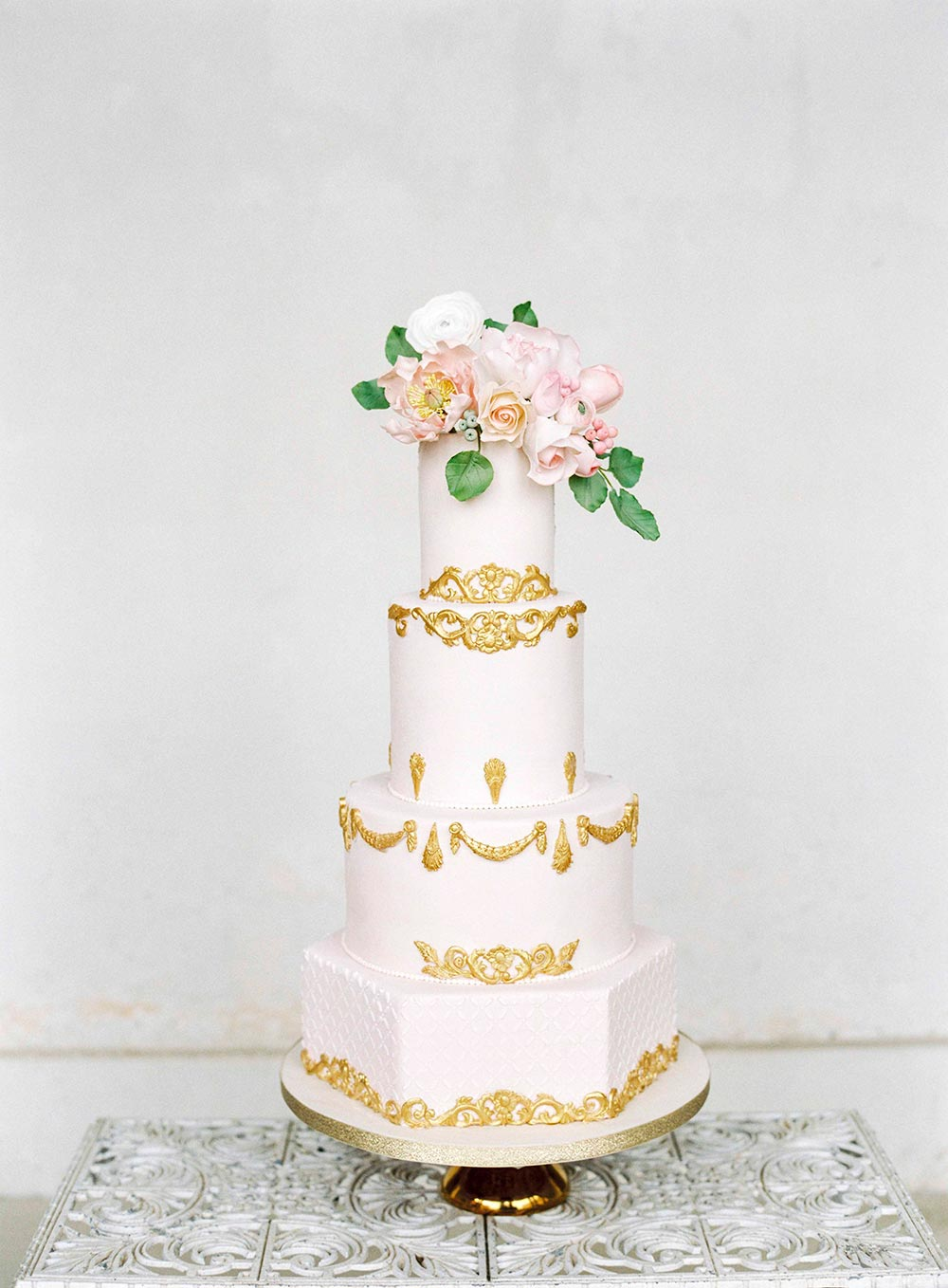 chic pink and gold wedding cake with French vintage patterns