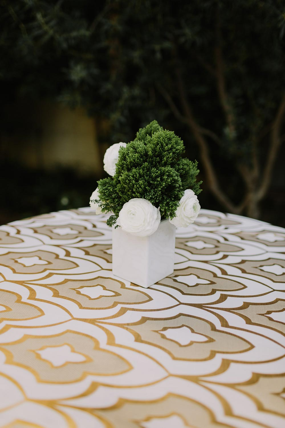 cocktail hour rich linens with mini boxwood centerpieces