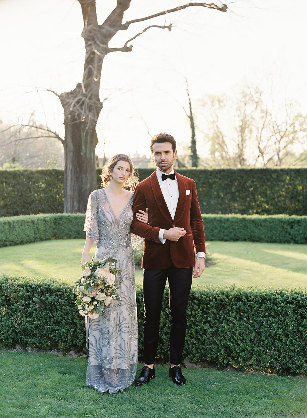 blue hand beaded wedding dress and burnt orange velvet groom suit