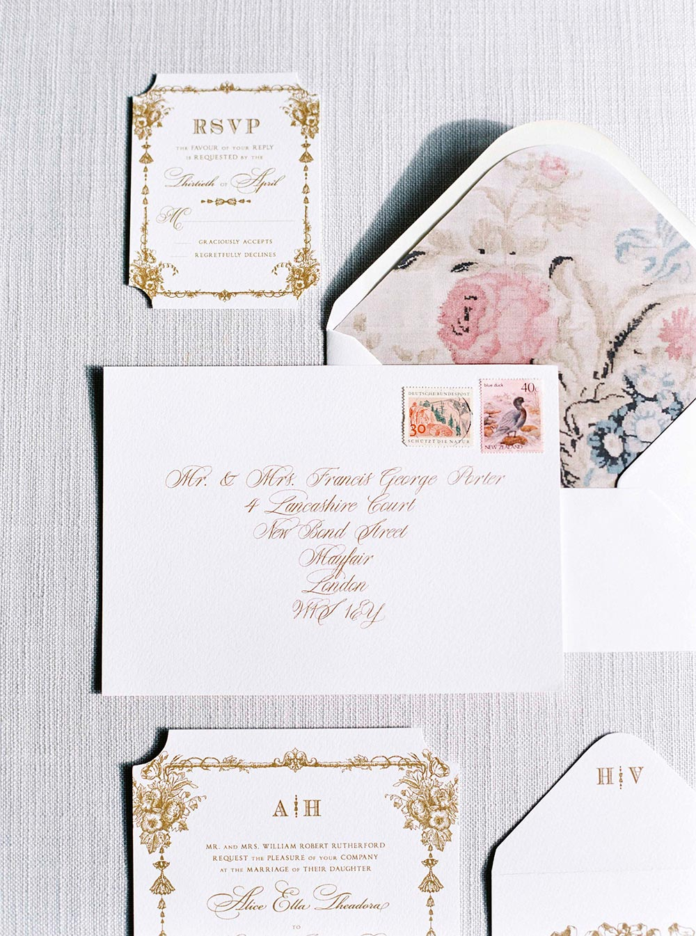 gold and white wedding invitation suite