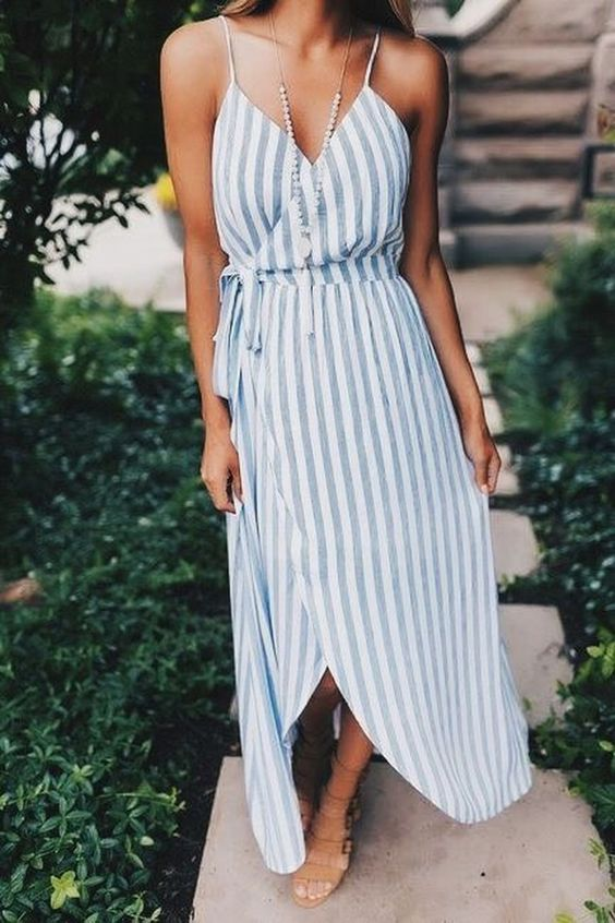 a striped spaghetti strap wrap midi dress and nude sandals are all you need for comfort