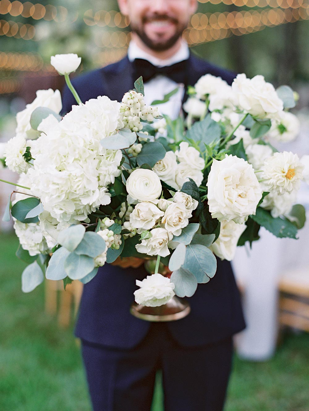 hydrangea garden rose ranunculi and eucalyptus wedding centerpiece