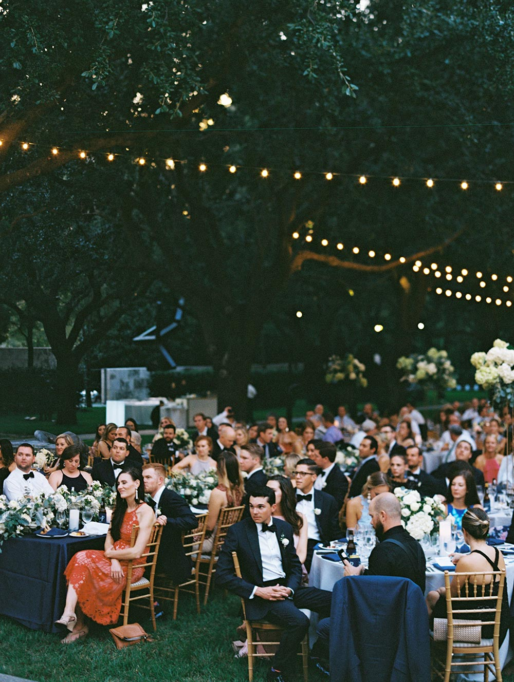 southern black tie wedding reception with string lights wedding guests