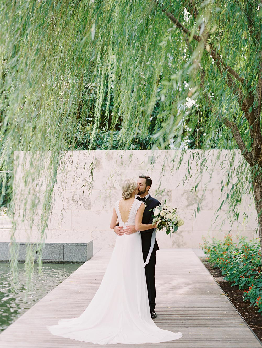 modern lace embroidered wedding dressed navy groom tux
