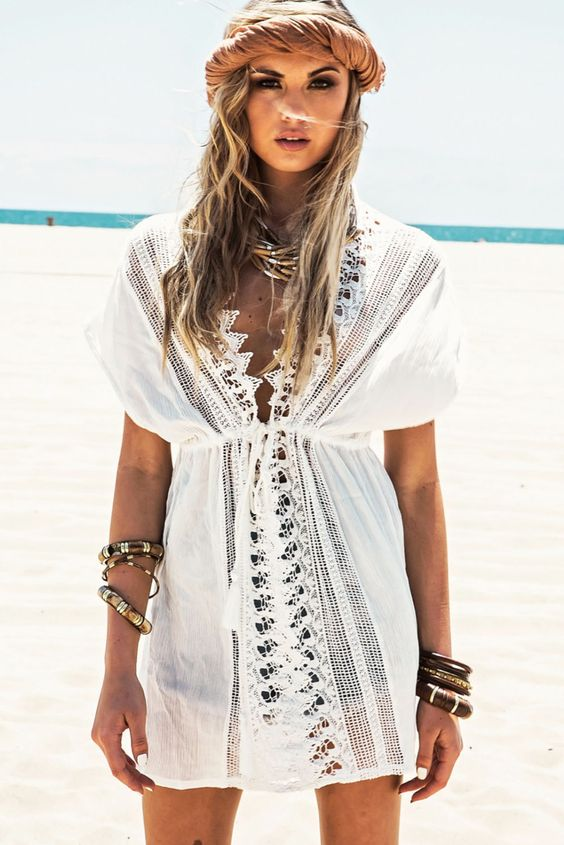 a sexy white beach tunic with a lace trim and a V-neckline plus short sleeves