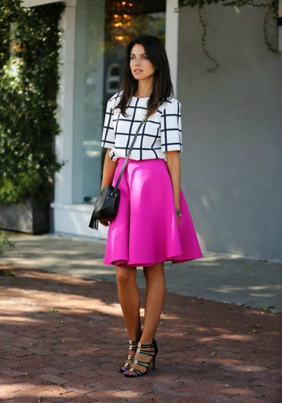 a hot pink A-line skirt, a windowpane top and blakc strappy shoes